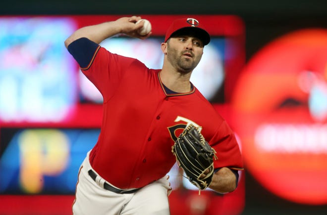 Twins pitcher Matt Magill eyes the target during an April 26 game against the Orioles in Minneapolis. After making 40 appearances last season with Minnesota, the Royal High graduate has made four since being recalled from Triple-A.