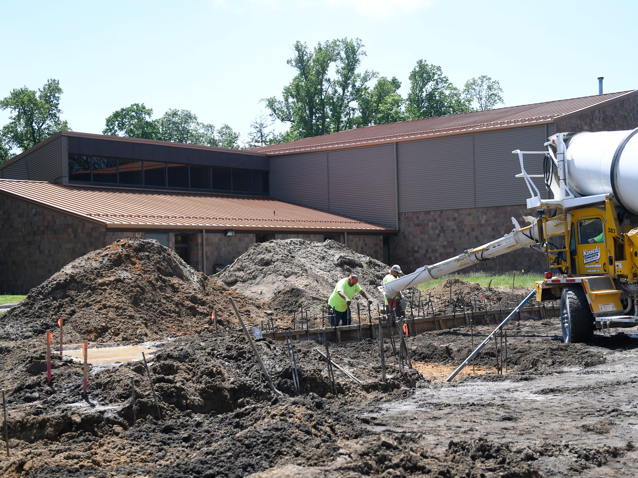 Crews from Charles Marandino concrete worked on curbing for the back parking lot of the Vineland Library on Tuesday, May 7, 2019.