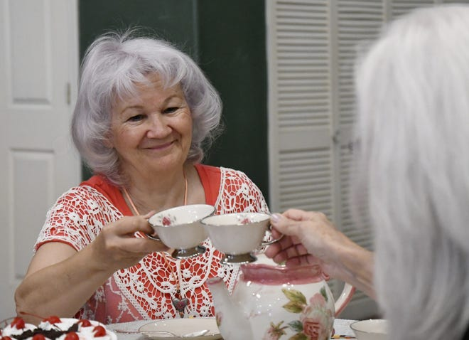 Crystal Burchnell speaks to Laurie Kathleen at a Death Cafe meeting at the Center for Spiritual Living on Friday, May 3, 2019.