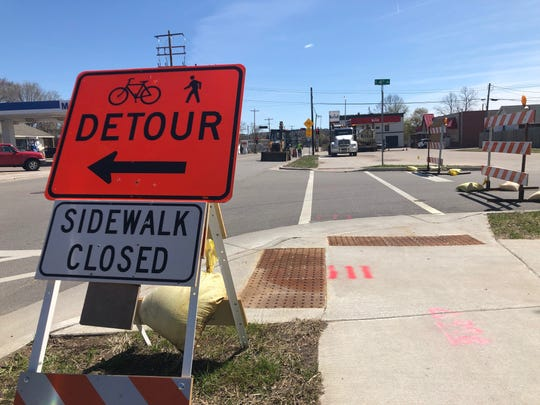A sign tells bikers and pedestrians to avoid the construction on Thomas Street on May 7, 2019.