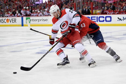 Carolina Hurricanes defenseman Brett Pesce (22) skates with the puck against Washington Capitals right wing Tom Wilson (43) during the second period of Game 7 of an NHL hockey first-round playoff series, Wednesday, April 24, 2019, in Washington.