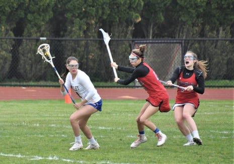 Ardsley's Morgan Fodiman (l), The Journal News/lohud girls lacrosse Player of the Week, carries the ball against Sleepy Hollow last week. She had four goals against the Headless Horsemen and 13 overall during the week.