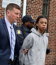 Jamir Thompson, the alleged shooter in the killing of Marilyn Cotto Montanez, is escorted out of the Yonkers Police Department Youth Services Division on North Broadway in Yonkers, May 7, 2019.