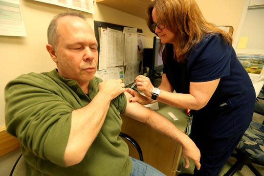 Bruce Reitman of South Salem gets a hepatitis A vaccine from Lourdes Goldsmith, a public health nurse for the Westchester Department of Health, during a walk-in hepatitis A vaccine clinic in White Plains May 7, 2019. Rietman had been a patron at Winston, the Mount Kisco restaurant where an infected worker may have exposed patrons to hepatitis A.