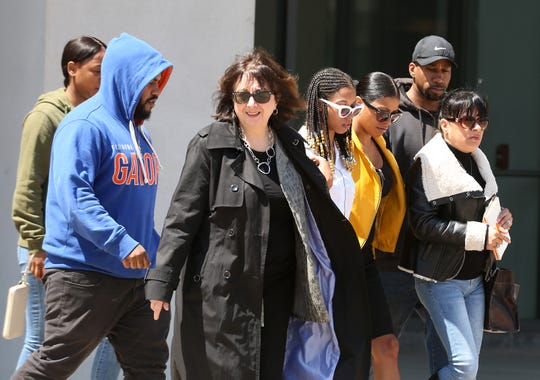 Lisa Pelosi, attorney for defendant Jamir Thompson, walks  out of Westchester County Court with his relatives following his arraignment May 7,  2019. Thompson turned himself in to Yonkers police earlier today.