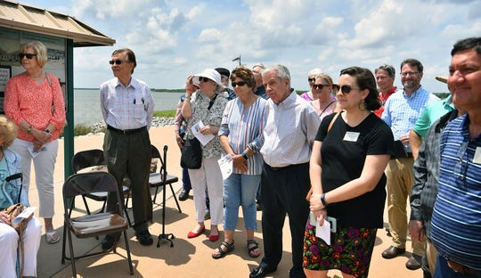 Atendees watch during the unveiling of a Texas Historical Commission marker at Lake Wichita Tuesday afternoon.