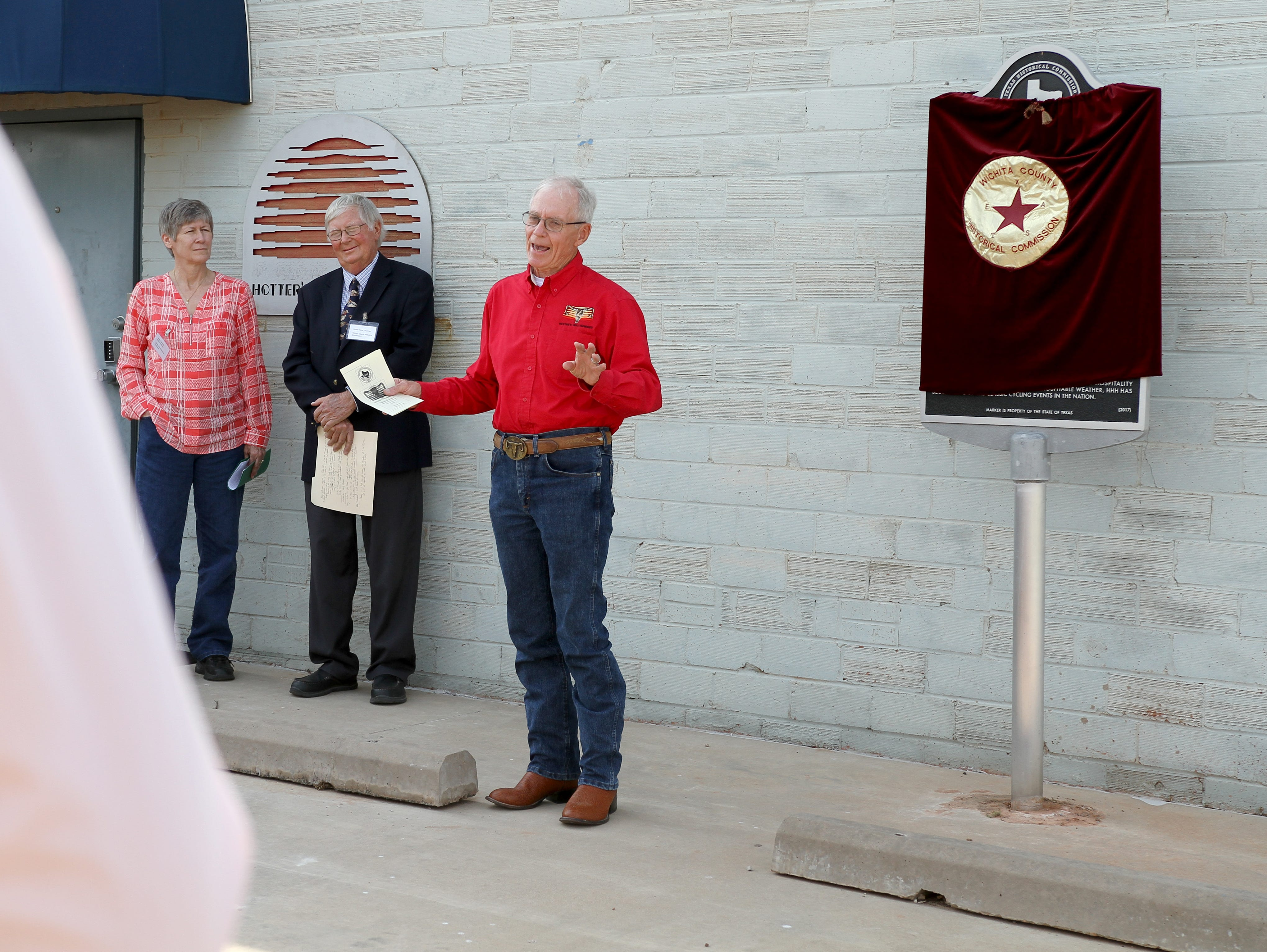 Roby Christie gives a speech as the Wichita County Historical Commission recognizes the Hotter'N Hell Hundred Monday, May 6, 2019, with an Official Texas Historical Marker at a dedication ceremony at the HH100 Clubhouse at 104 Scott.