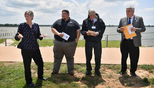 Becly Trammell speaks Tuesday afternoon during the unveiling of a historical marker at Lake Wichita. From left, Trammell is the marker chair, Wichita County Historical Commission, Tom Lang of the Lake Wichita Revitalization Committee, Robert Palmer, chairman of the WCHC and city councilor Tim Brewer.