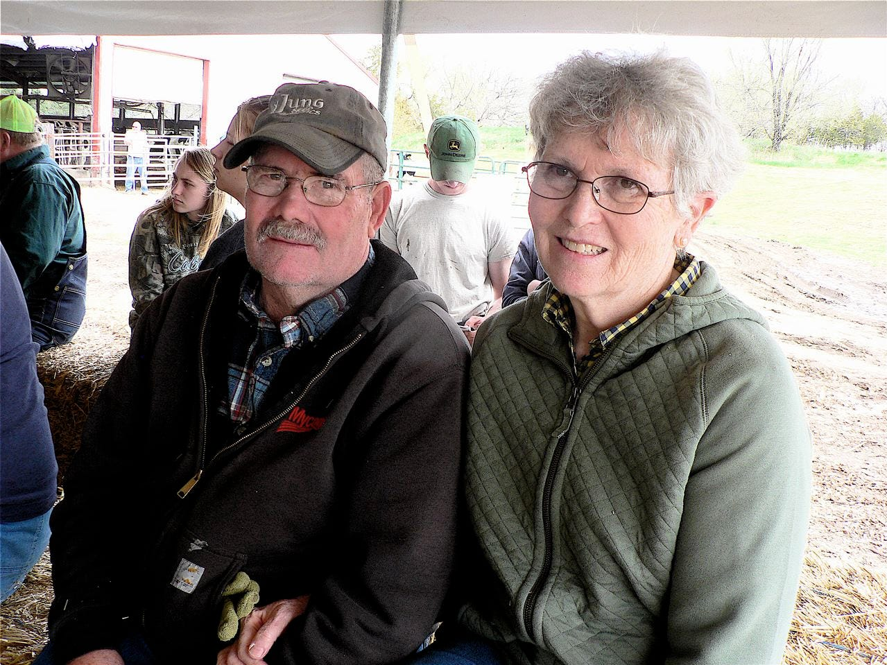 Tom and Mary Heinze watch the cattle go, selling the cows to Mark and Beth in 2012.