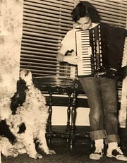 Jean Steffen Krueger's dog Butch serenades her as she plays the accordion in the living room of the old farmhouse near Dotyville, Wis.
