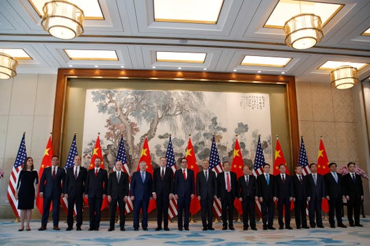 May 1, 2019, file photo, members of U.S. and China delegation led by Chinese Vice Premier Liu He, U.S. Treasury Secretary Steven Mnuchin and U.S. Trade Representative Robert Lighthizer, stand for a group photo session after their meeting at the Diaoyutai State Guesthouse in Beijing. Chinese envoys are preparing to travel to the United States for trade talks, a government spokesman said.