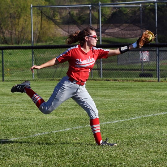 Alyssa Gettys makes a running catch in right field during Sheridan's 13-0 win against Washington Court House on Monday in a Division II sectional game in Thornville.