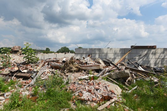 A sea of debris stretches along Linden Avenue in Zanesville, the ruins of a large building that once housed GE, United Technologies, Lear. Demolition was halted five years ago by the city and the rubble remains.