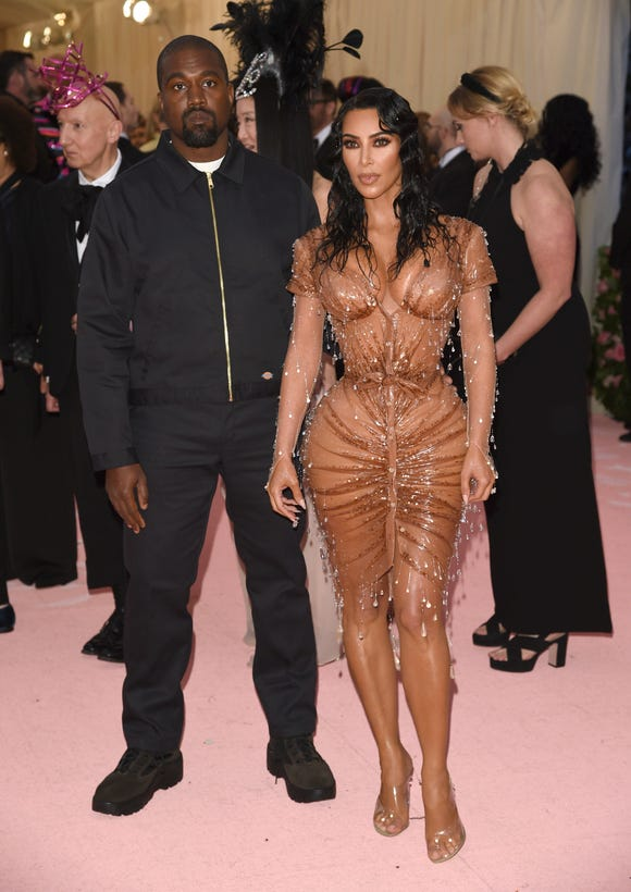 Kim Kardashian showed off her famous curves and a wet-hair look alongside husband Kanye West.