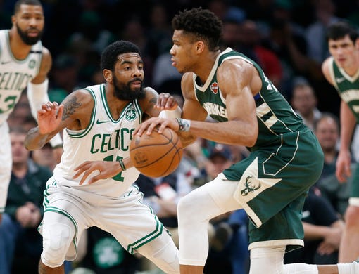 May 6: Bucks forward Giannis Antetokounmpo (34) looks for room to drive against Celtics defender Kyrie Irving (11) during Game 4 in Boston.