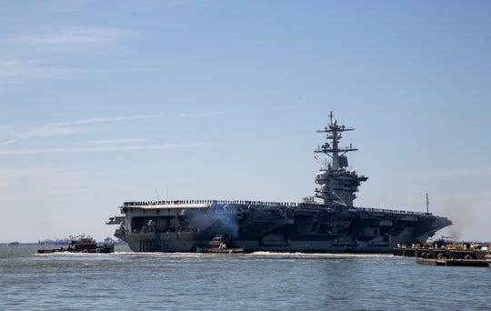 In this April 1, 2019, file photo, the USS Abraham Lincoln deploys from Naval Station Norfolk, in the vicinity of Norfolk, Va. The White House said Sunday, May 5, that the U.S. is deploying military resources to send a message to Iran. White House national security adviser John Bolton said in a statement that the U.S. is deploying the USS Abraham Lincoln Carrier Strike Group and a bomber task force to the U.S. Central Command region, an area that includes the Middle East. (Kaitlin McKeown/The Virginian-Pilot via AP, File)