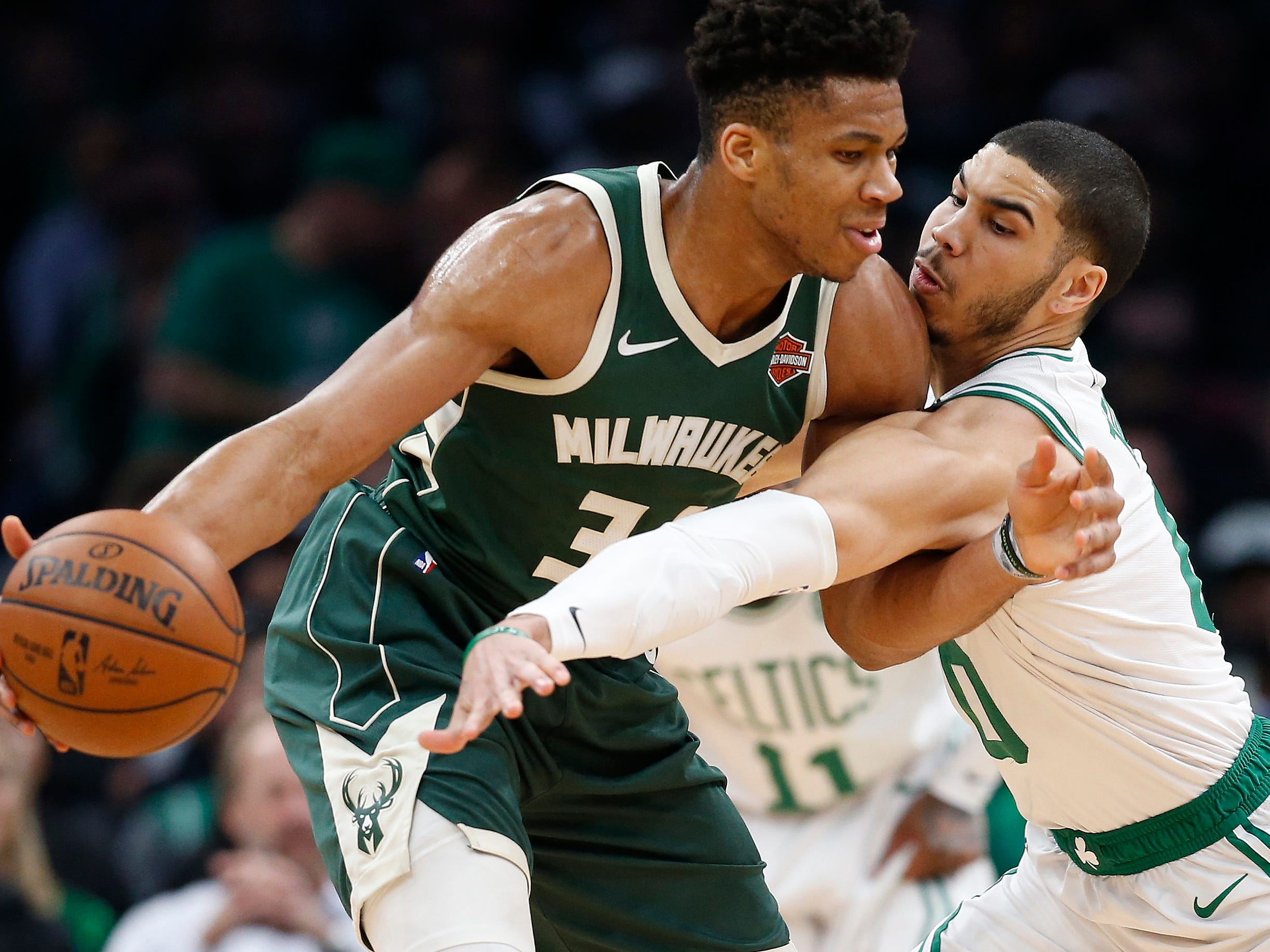 May 6: Bucks forward Giannis Antetokounmpo (34) tries to keep the ball away from Celtics defender Jayson Tatum (0) during Game 4.