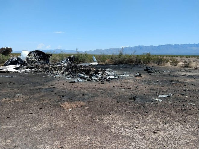 A handout photo made available by La Voz de Monclova newspaper shows wreckage of a private jet that disappeared in the northern Mexican state of Coahuila en route from Las Vegas. All 13 people aboard were killed in the crash.