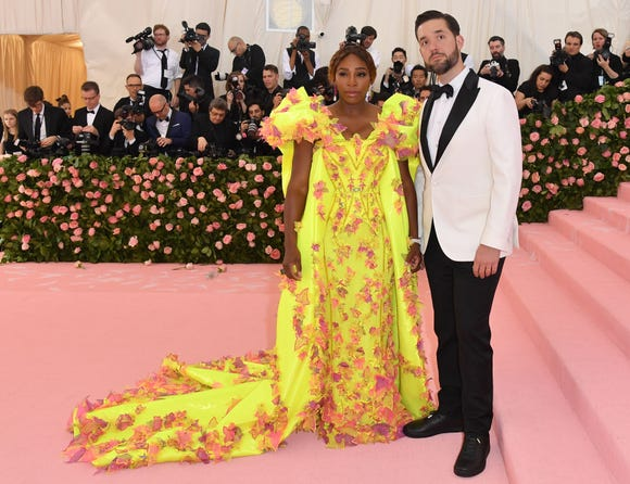Met Gala co-host Serena Williams looks super glam next to husband Alexis Ohanian.