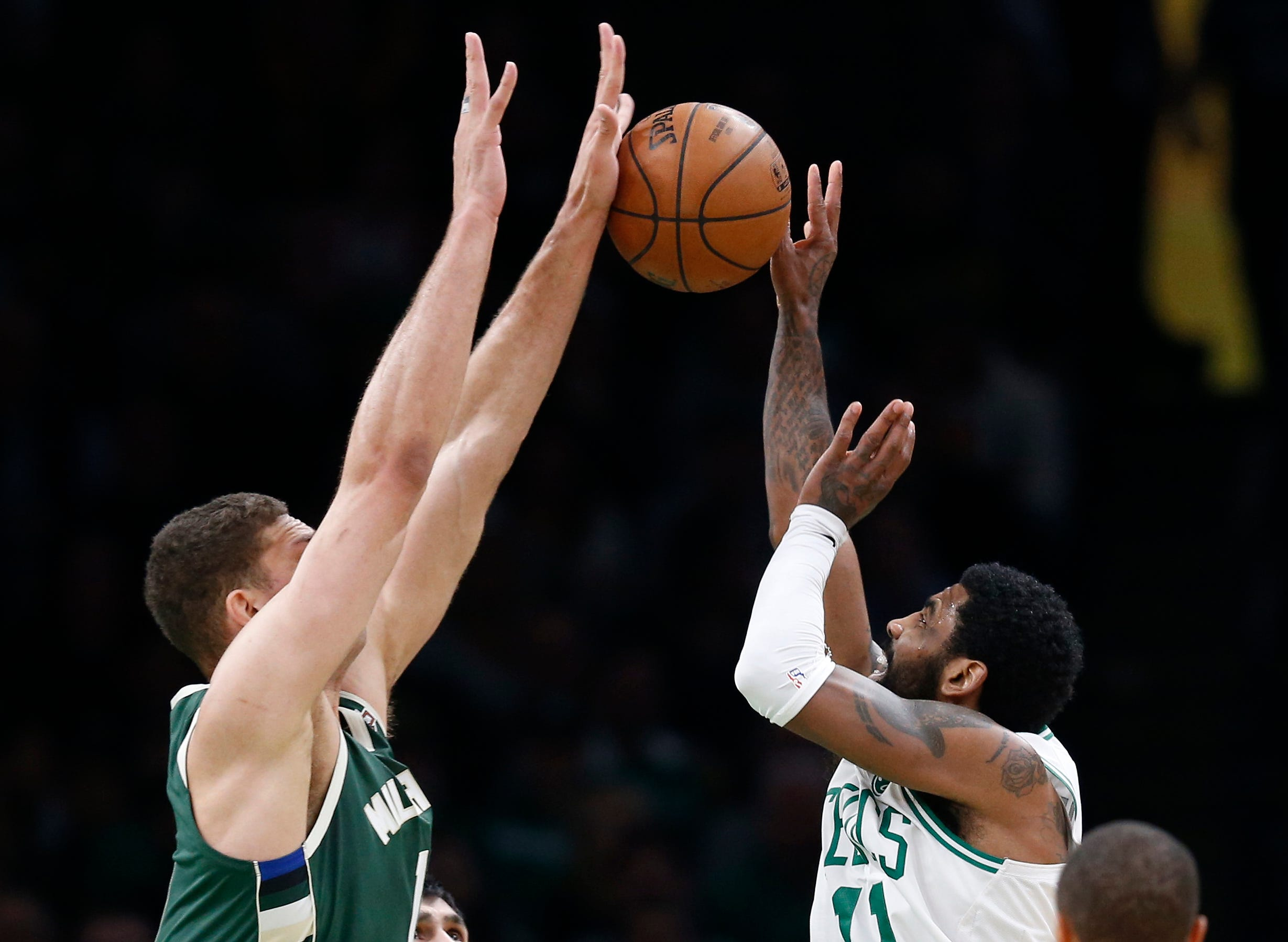 May 6: Bucks center Brook Lopez (11) blocks a shot attempt by Celtics guard Kyrie Irving (11) during Game 4.