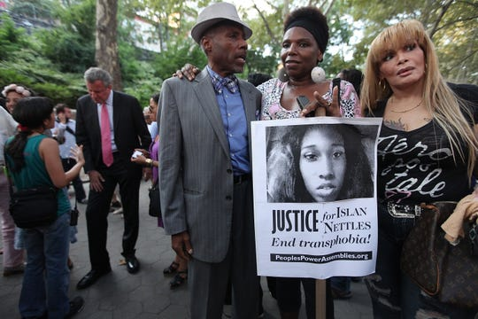 People gather before a vigil for slain transgender woman Islan Nettles at Jackie Robinson Park in Harlem on August 27, 2013 , in New York City.