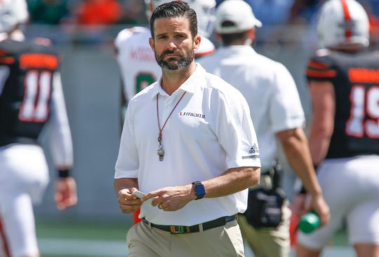 Miami (Fla.) coach Manny Diaz walks on the field during warmups before the team's spring game.
