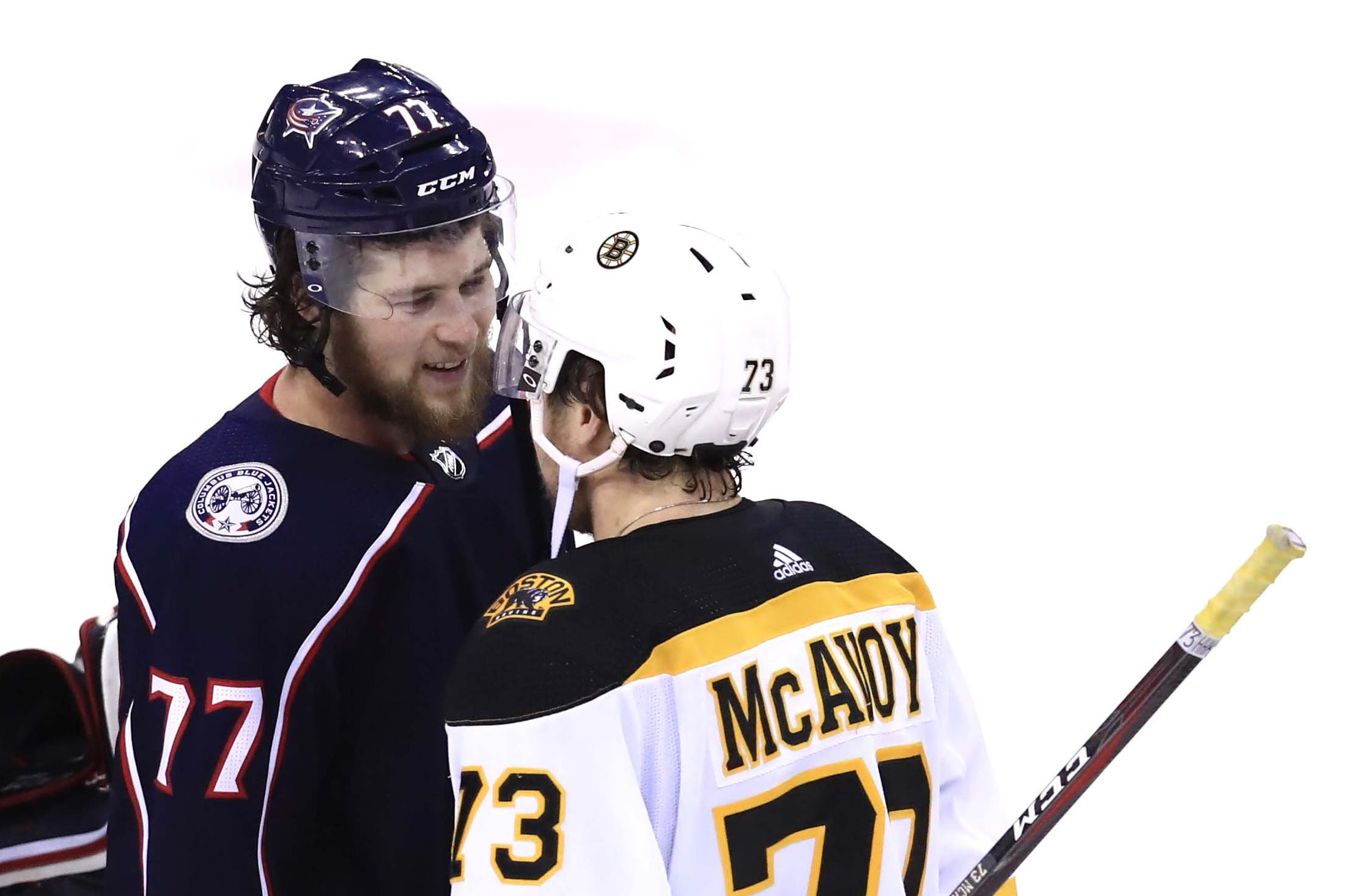Second round: Blue Jackets right wing Josh Anderson, left, chats with Charlie McAvoy after Game 6. The Bruins defenseman had knocked Anderson temporarily out of the game with a hit to the head.