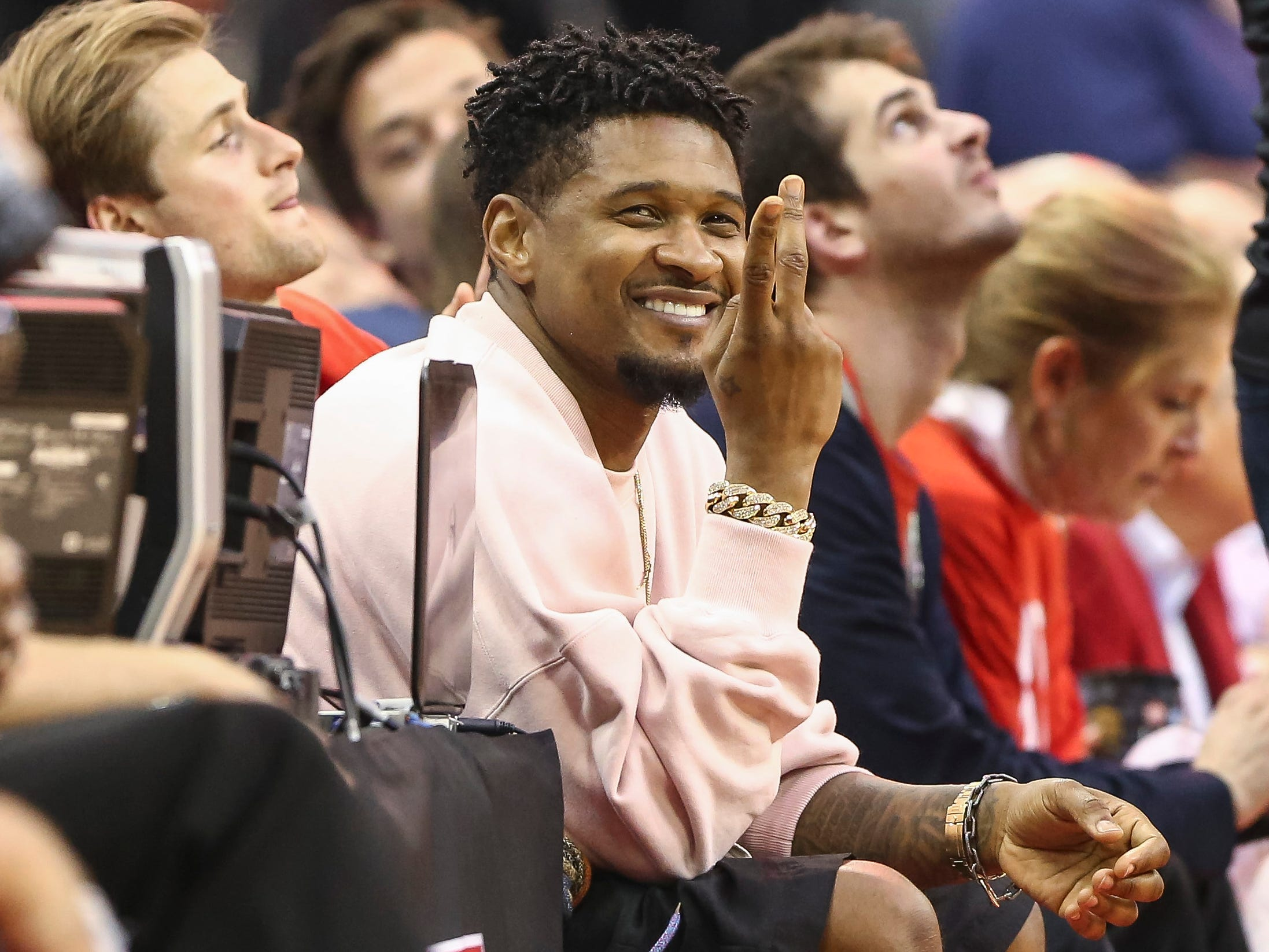 May 6: Singer Usher takes in Game 4 between the Rockets and Warriors in Houston.