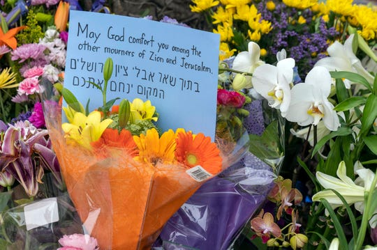 Flowers at a makeshift memorial outside Chabad of Poway synagogue on April 28, 2019.