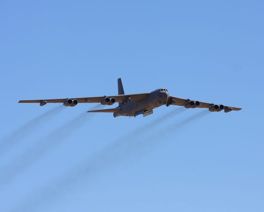 Boeing B-52 Stratofortress flying at the Edwards AFB open house with bomb bay doors open.