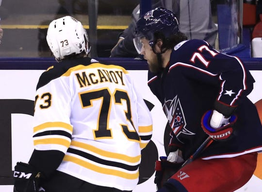 Bruins defenseman Charlie McAvoy is called for an illegal check to the head against Blue Jackets right wing Josh Anderson.