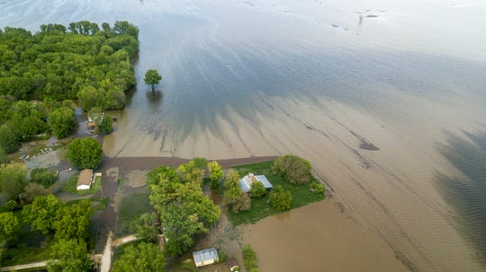 Water from the swelling Mississippi River covers roadways and approaches houses on May 4, 2019, in Winfield, Mo.