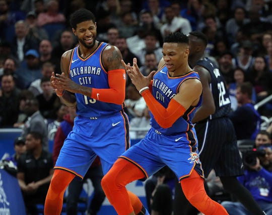 Oklahoma City Thunder teammates Paul George, left, and Russell Westbrook  each had surgeries on Tuesday.