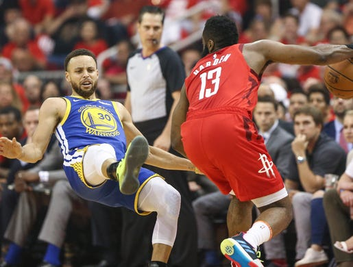 May 6: Warriors defender Steph Curry (30) takes the bump from Rockets guard James Harden (13) and falls to the floor during Game 4 in Houston.