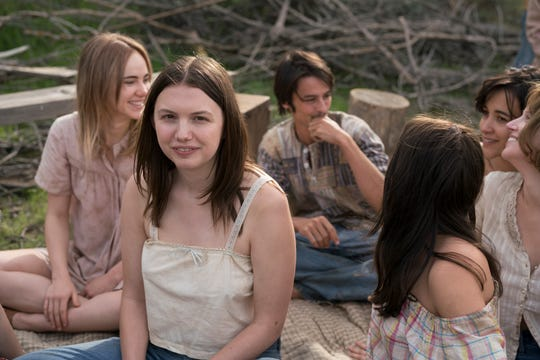 "Hannah Murray (center) plays Leslie Van Houten, a teenage runaway who falls under the charismatic sway of Charles Manson in ""Charlie Says."""