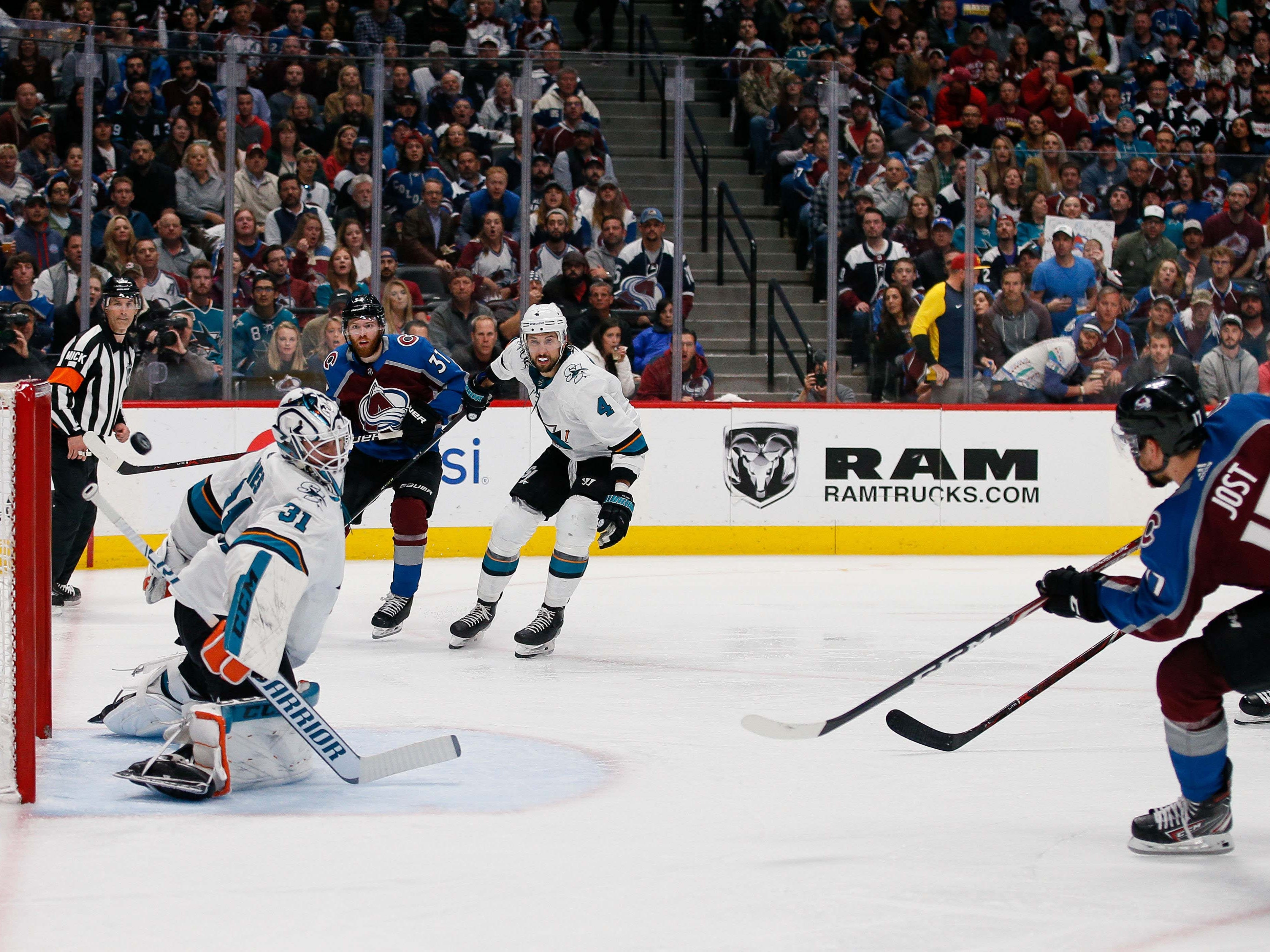 Second round: Colorado Avalanche center Tyson Jost (17) scores a goal past San Jose Sharks goaltender Martin Jones  in the second period Game 6 at the Pepsi Center.
