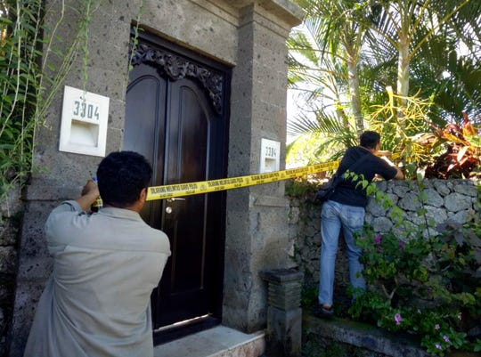 Officers put up police line around a villa on May 4, 2019, where Australian DJ Adam Neat was found dead.