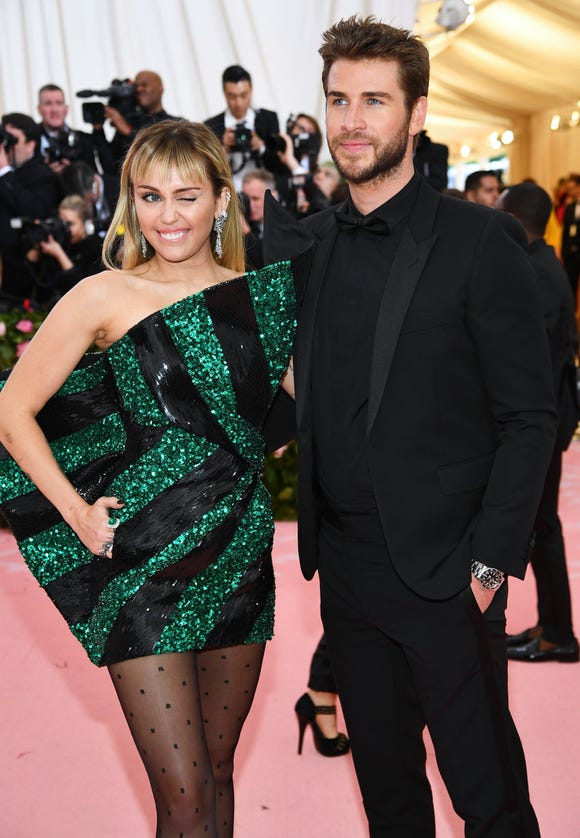 Miley Cyrus gives a wink next to hubby Liam Hemsworth.