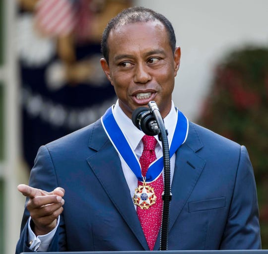 Tiger Woods speaks at a ceremony after being presented with the Presidential Medal of Freedom.