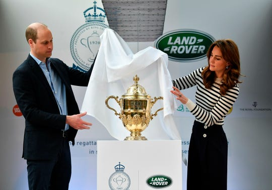 Prince William and Duchess Kate of Cambridge unveil the King's Cup trophy as they launch the King's Cup Regatta, in Greenwich on May 7, 2019. The regatta, to take place on Aug. 9, will see them go head to head as skippers of sail boats in the race.