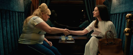 "Rebel Wilson's Penny Rust and Anne Hathaway's Josephine Chesterfield aren't always this friendly in ""The Hustle."""