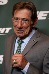 Former New York Jets quarterback Joe Namath poses for photographers on the green carpet ahead of an event unveiling the NFL football team's new uniforms Thursday, April 4, 2019.