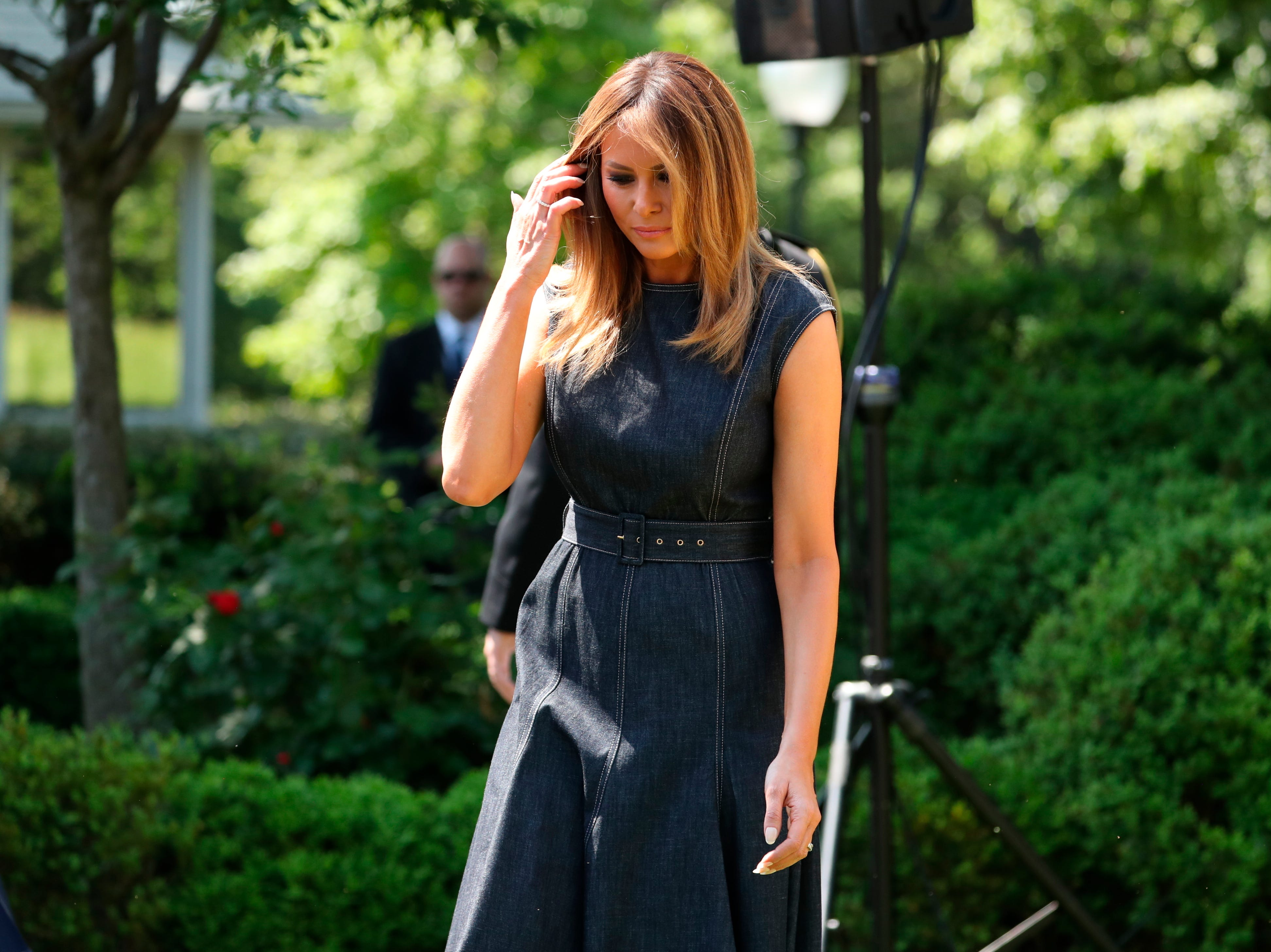 First lady Melania Trump walks out to begin a program for the first lady's Be Best initiative in the Rose Garden of the White House, Tuesday, May 7, 2019, in Washington.
