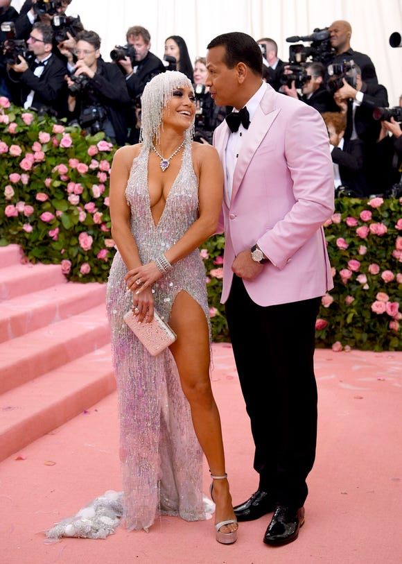 J.Lo rocked sparkles from head to toe next to A-Rod, who matched her in a pale pink tuxedo jacket.