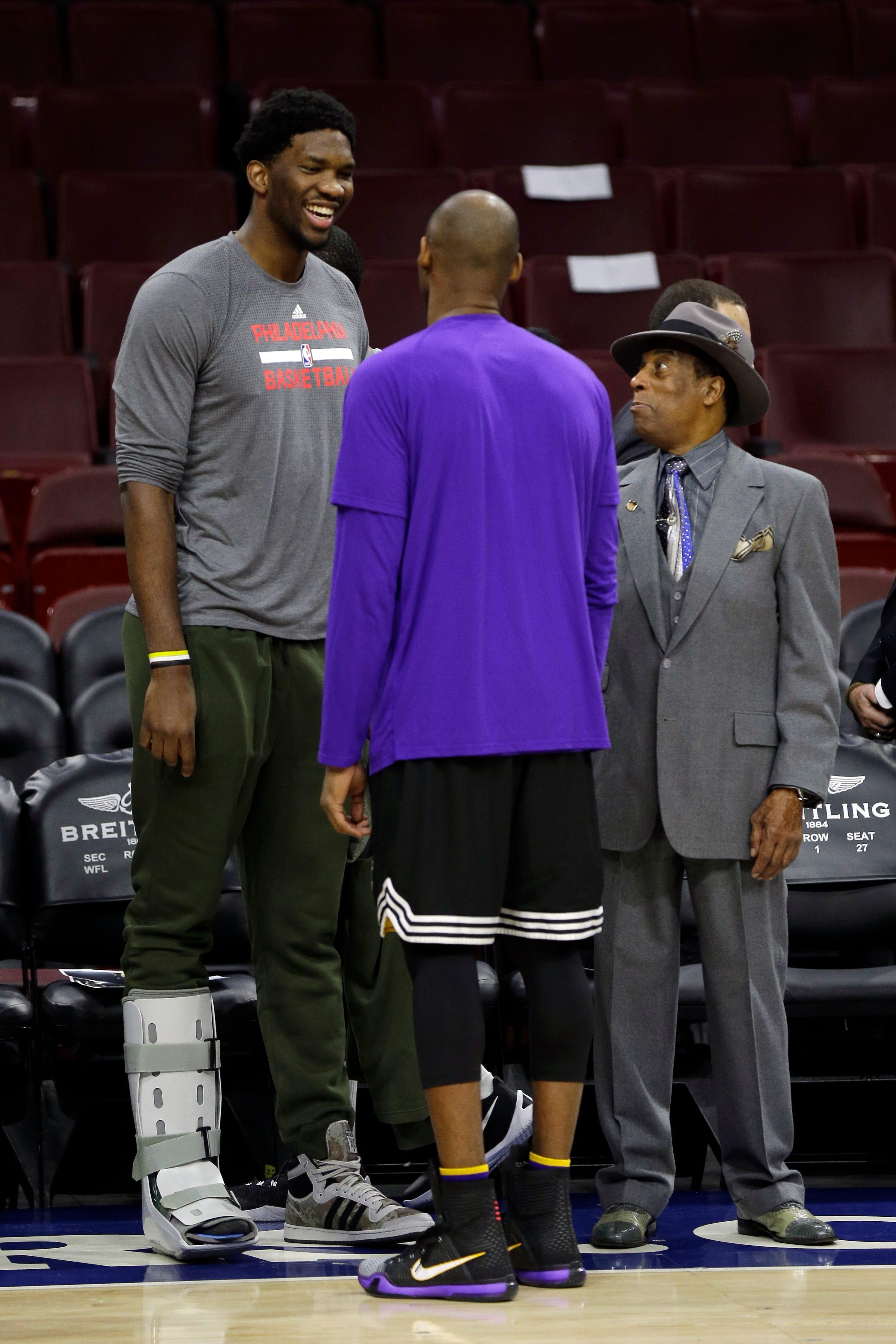 Philadelphia 76er Joel Embiid speaks with Sonny Hill (left) and Kobe Bryant in 2015.