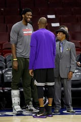 Philadelphia 76er Joel Embiid speaks with Sonny Hill (left) and Kobe Bryant in 2015.