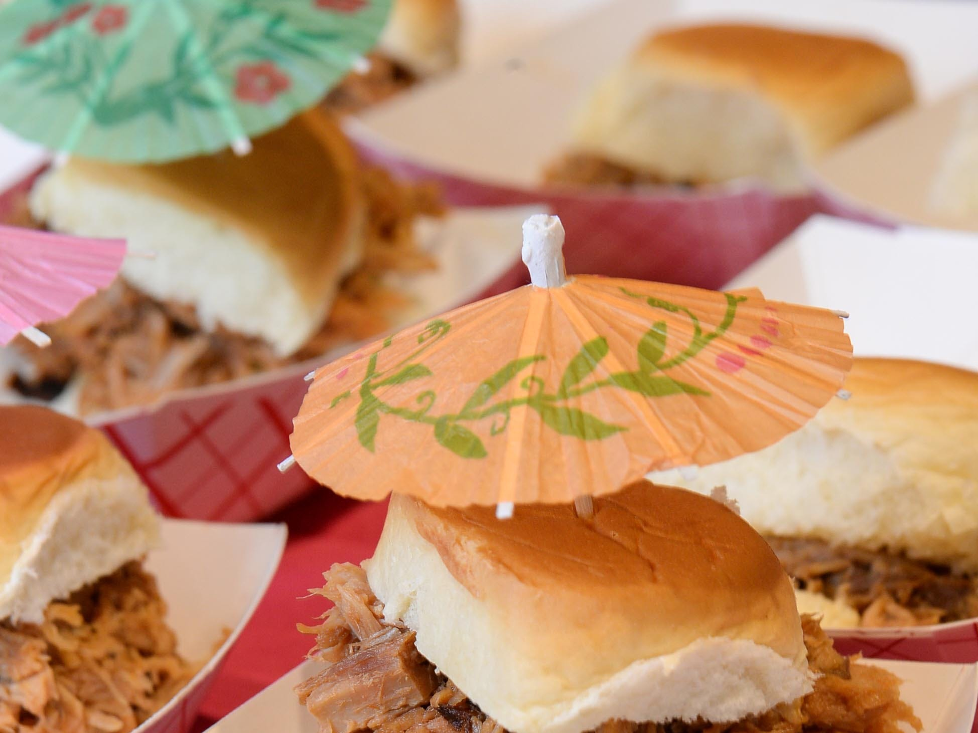A barbecue slider with paper umbrella from Arnold's at the Anderson Area YMCA Ralph Hayes Toyota Taste of Anderson at The Bleckley Station Tuesday. Proceeds from the Aloha theme party benefit programs and services of the Anderson Area YMCA.