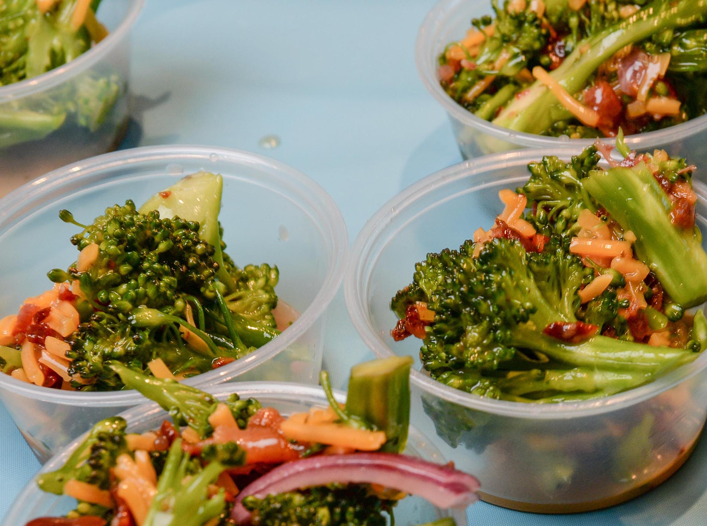 Broccoli salad from Mama Penn's at the Anderson Area YMCA Ralph Hayes Toyota Taste of Anderson at The Bleckley Station Tuesday. Proceeds from the Aloha theme party benefit programs and services of the Anderson Area YMCA.