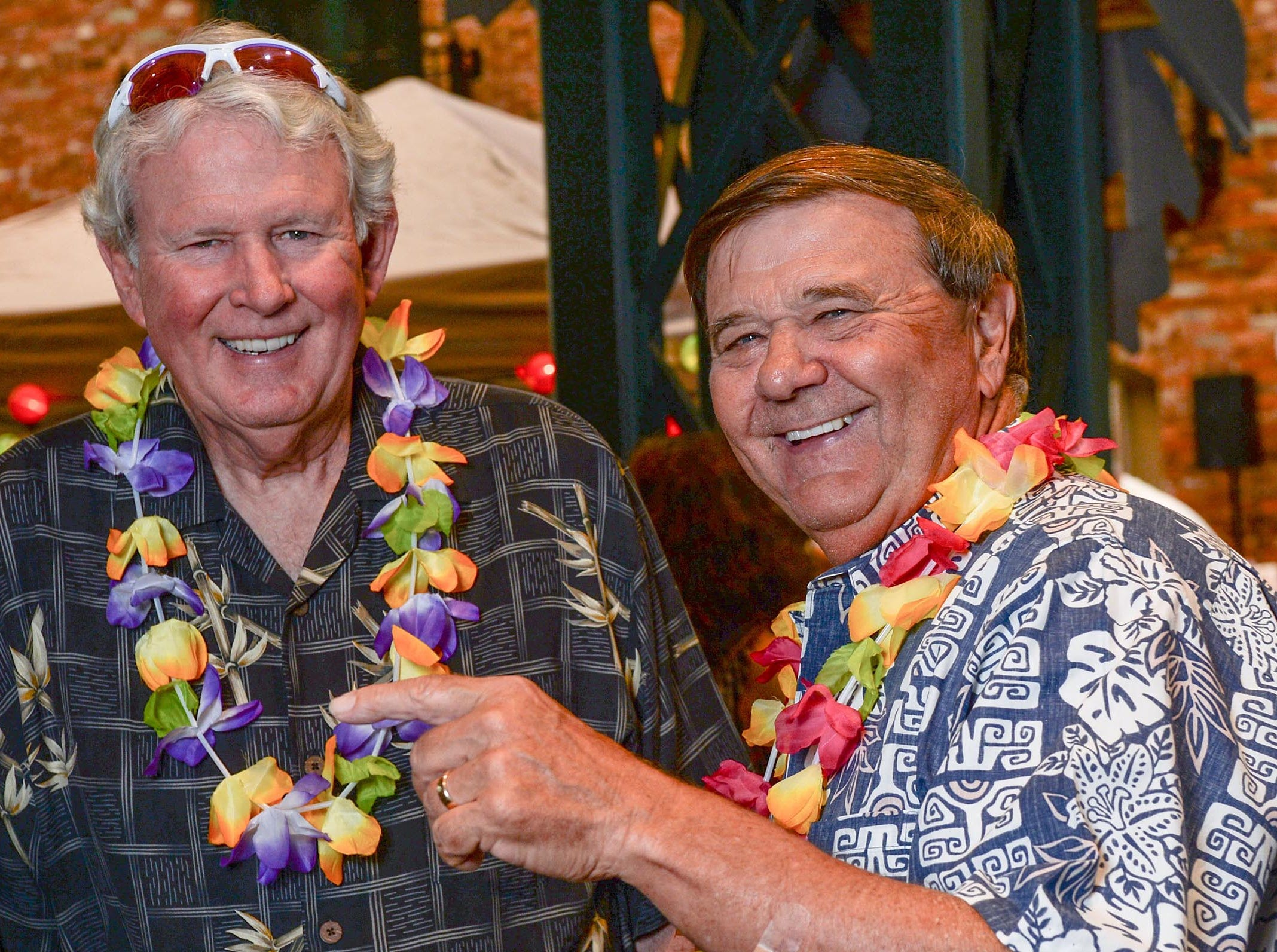John Miller, Jr., left, and Steve Kay, during the Anderson Area YMCA Ralph Hayes Toyota Taste of Anderson at The Bleckley Station Tuesday. Proceeds from the Aloha theme party benefit programs and services of the Anderson Area YMCA.