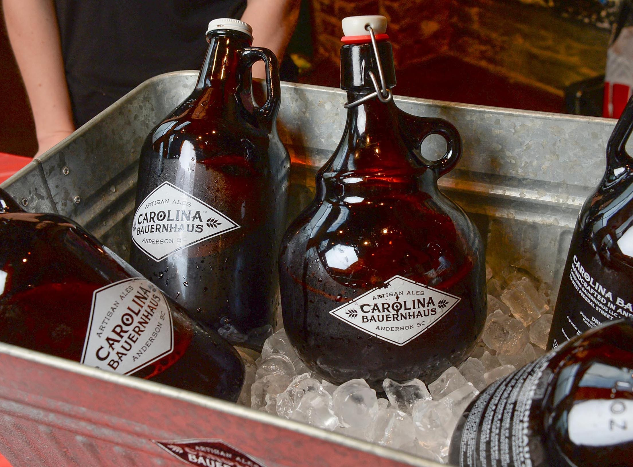 A variety of beer from Carolina Bauerhaus on ice during the Anderson Area YMCA Ralph Hayes Toyota Taste of Anderson at The Bleckley Station Tuesday. Proceeds from the Aloha theme party benefit programs and services of the Anderson Area YMCA.
